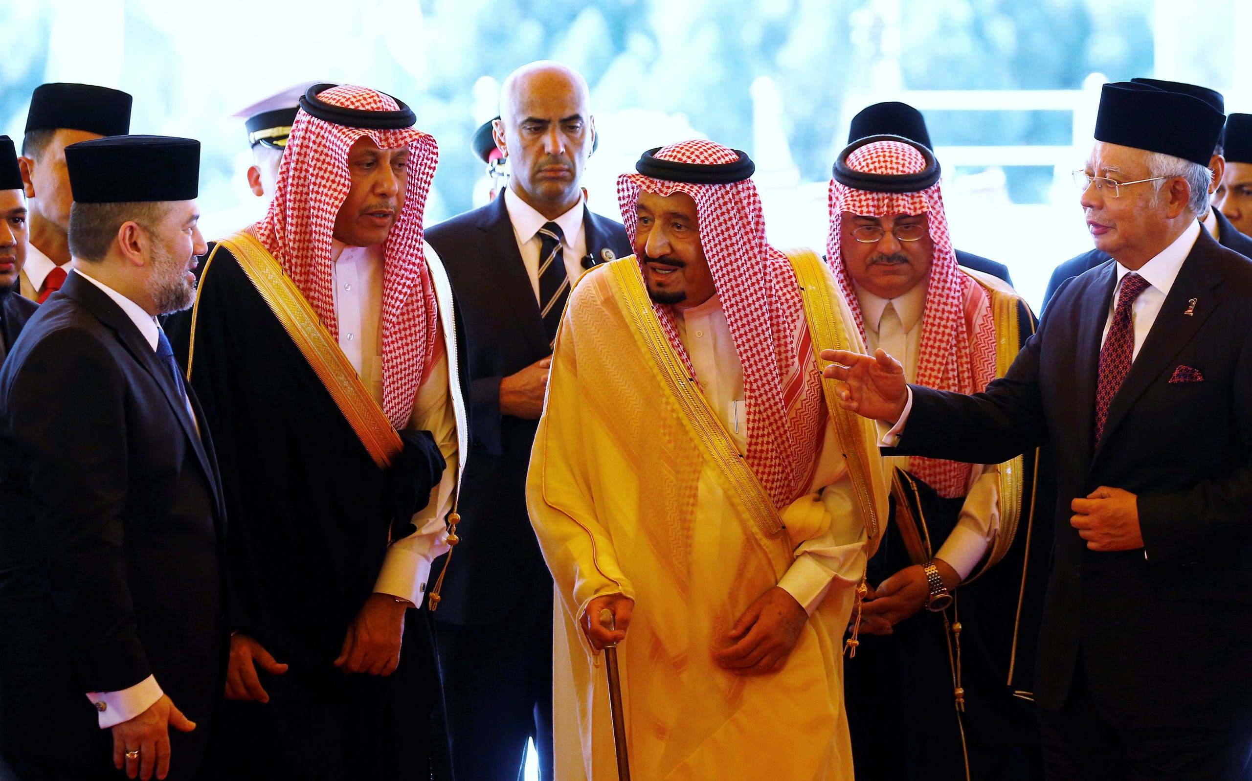 Saudi Arabia's King Salman leaves after inspecting an honor guard with Malaysia's Prime Minister Najib Razak (right) and Malaysia's King Muhammad V (left) at the Parliament House in Kuala Lumpur, on February 26, 2017. (Reuters)