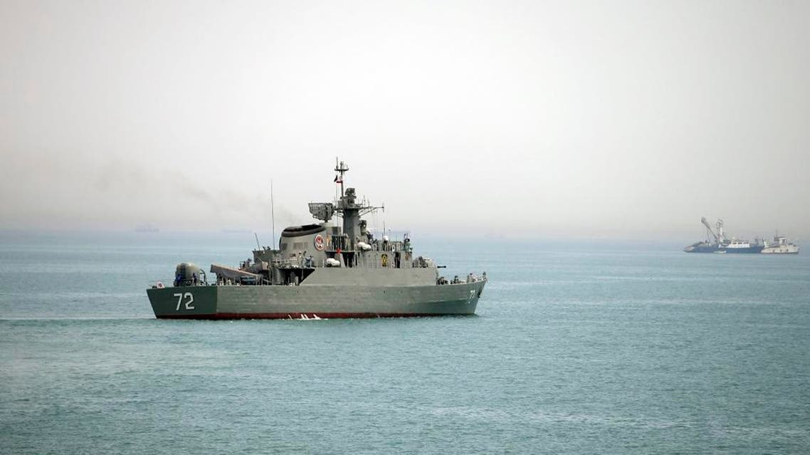 File photo of Iranian warship Alborz, foreground, as it leaves Iran's waters, at the Strait of Hormuz. (AP)