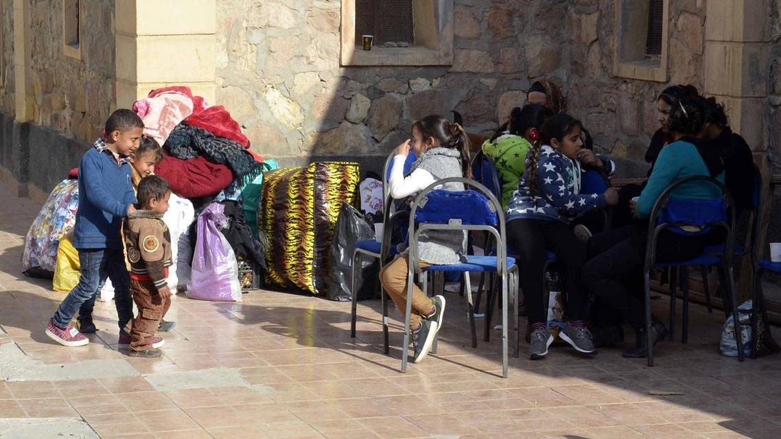 Egyptian Coptic Christians sit in the courtyard of the Evangelical Church in the Suez Canal city of Ismailiya on February 24, 2017, upon arriving to take refuge from Islamic State (IS) group jihadists. Dozens of Coptic Christians have left Egypt's Sinai Peninsula after a string of jihadist attacks killed three Christians in the restive province, church officials said. STRINGER / AFP
