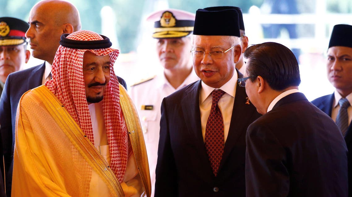 Saudi Arabia's King Salman (C) review the honor guard with Malaysia's King Muhammad V and Malaysia's Prime Minister Najib Razak (R) during a welcoming ceremony in Kuala Lumpur, Malaysia, February 26, 2017 رئيسية