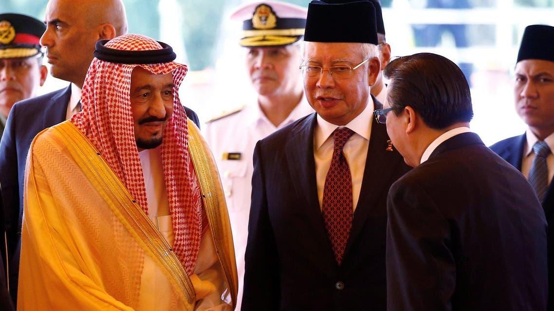Saudi Arabia's King Salman meets with ministers next to Malaysia's Prime Minister Najib Razak at the Parliament House in Kuala Lumpur, Malaysia, on February 26, 2017. (Reuters)