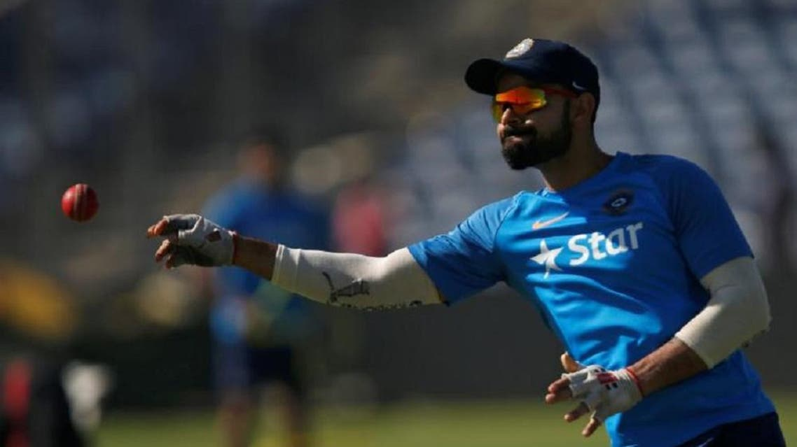 India's captain Virat Kohli throws a ball during a practice session ahead of their first test cricket match. (Reuters)