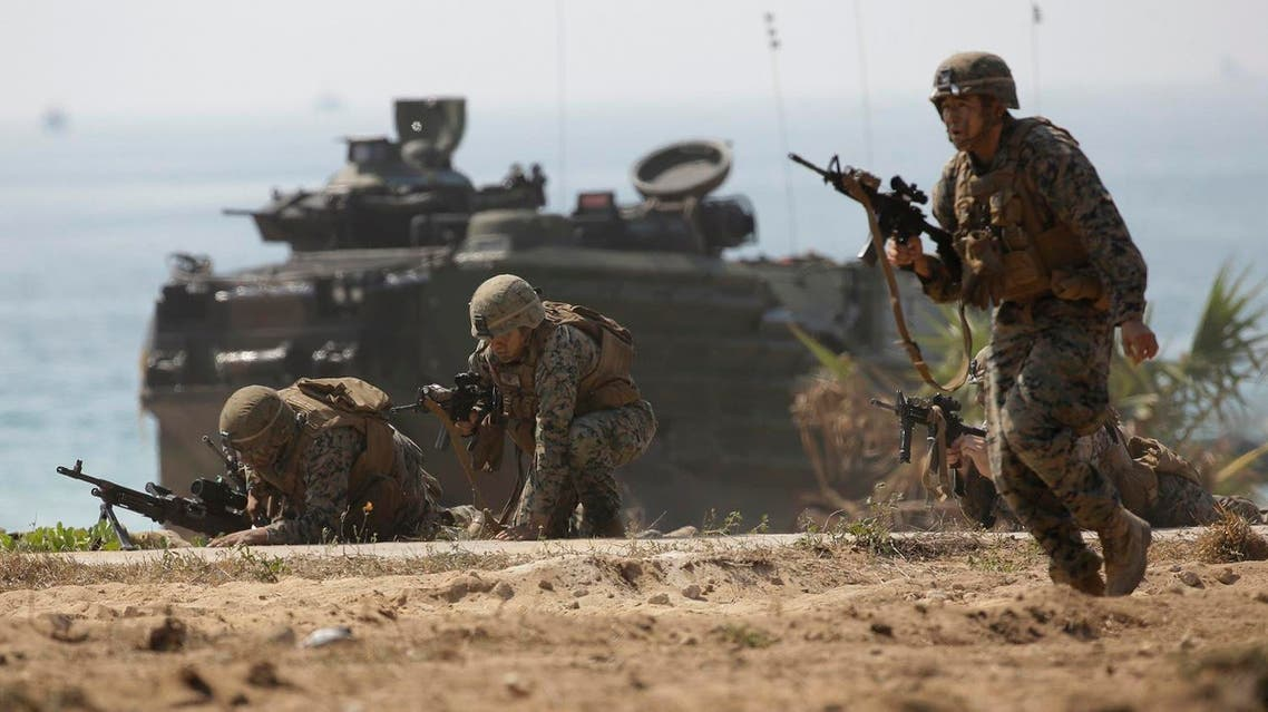 "U.S. soldiers land with an amphibious assault vehicle and secure the beach head during the ongoing U.S.-Thai joint military exercise titled ""Cobra Gold"" on Hat Yao beach in Chonburi province, eastern Thailand, Friday, Feb. 17, 2017. Twenty-nine countries, including China, India and Malaysia, are participating in or observing the exercises which started earlier in the week. Some 3,600 American troops are attending this year, hundreds more than last year. (AP)"