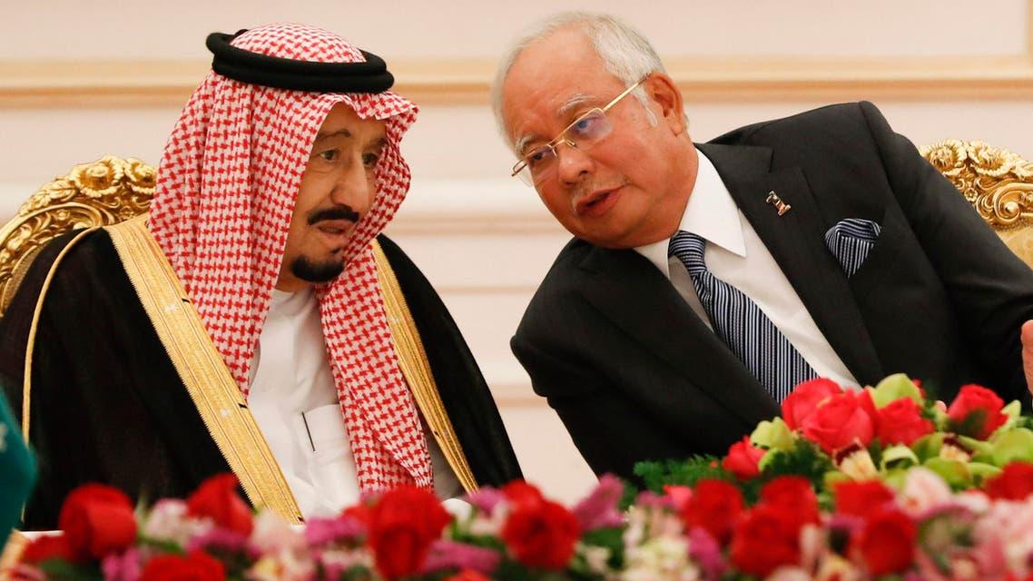 Saudi King Salman, left, listens to Malaysian Prime Minister Najib Razak during the MOU signing ceremony in Putrajaya, Malaysia, Monday, Feb. 27, 2017. (AP)
