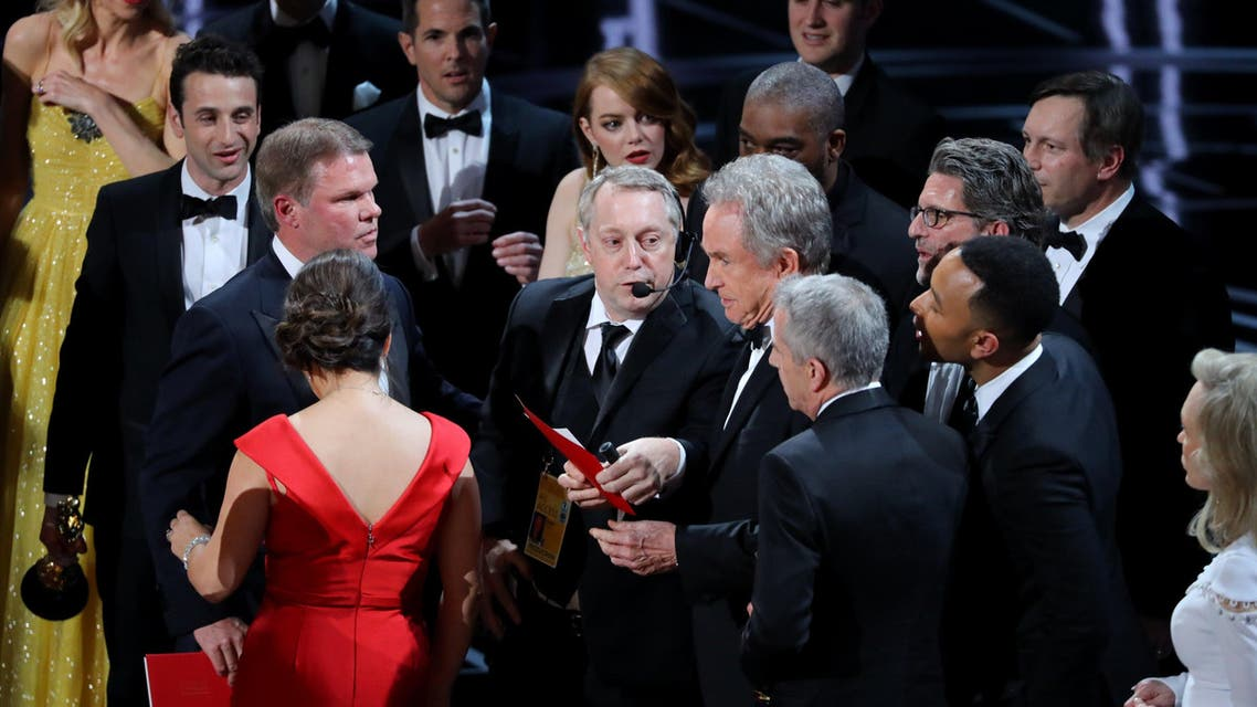 Fred Berger, Jordan Horowitz, Marc Platt, accept the oscar for Best Picture before the mistake was noticed. REUTERS/Lucy Nicholson