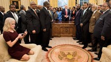 Trump aide Conway causes social media storm for kneeling on White House sofa