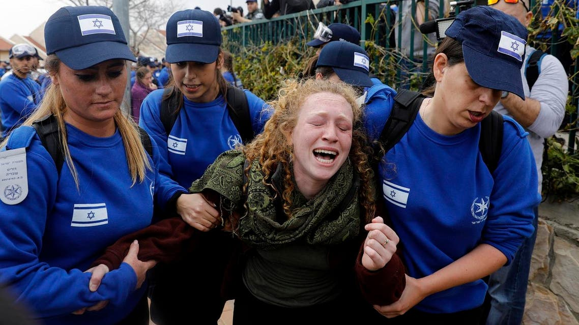 An Israeli youth supporter of settlements cries as Israeli police forces move protestors away from a house which is due to be demolished in the settlement of Ofra in the occupied West Bank, on February 28, 2017. (AFP)
