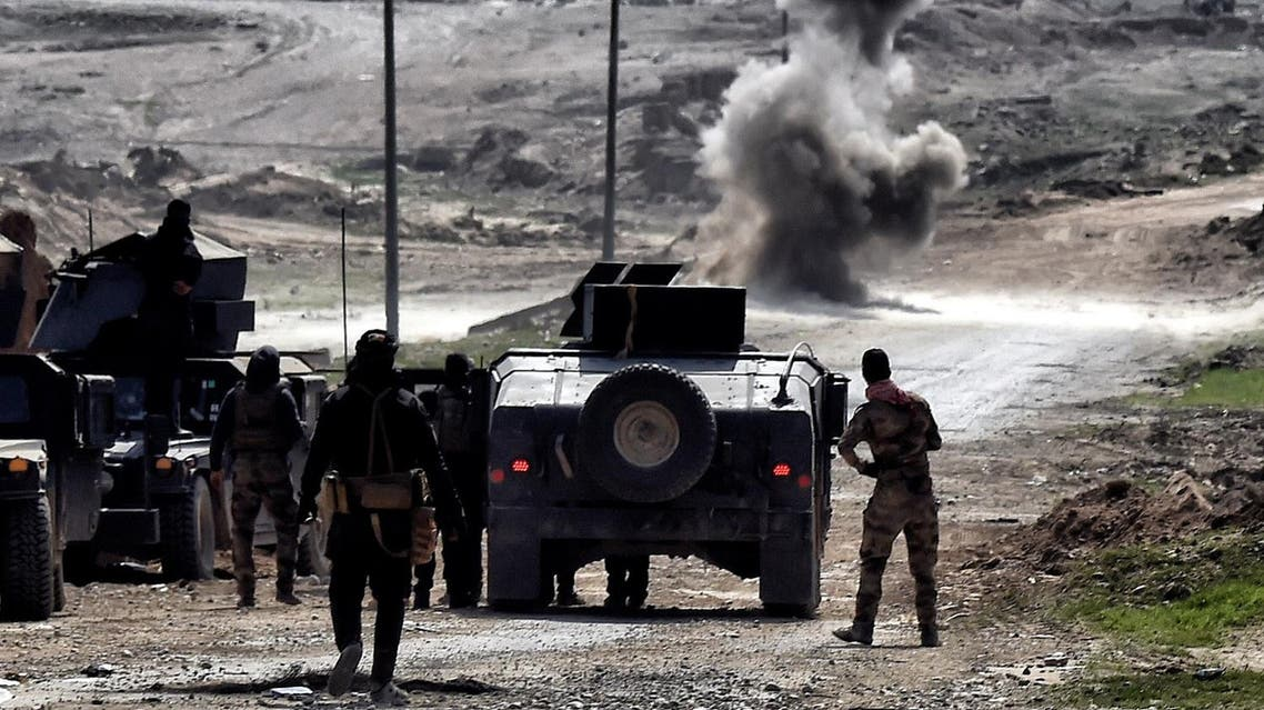 Iraqi troops blow up a mine on the outskirts of Mosul as Iraqi forces battle against Islamic State (IS) group jihadists to recapture the west of the city on February 28, 2017. Hundreds of civilians fled through the desert to escape fighting and privation in Mosul, joining thousands of others who left their homes as conditions worsen in the city's west.  ARIS MESSINIS / AFP
