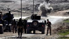 Iraqi army controls main roads out of Mosul, trapping ISIS