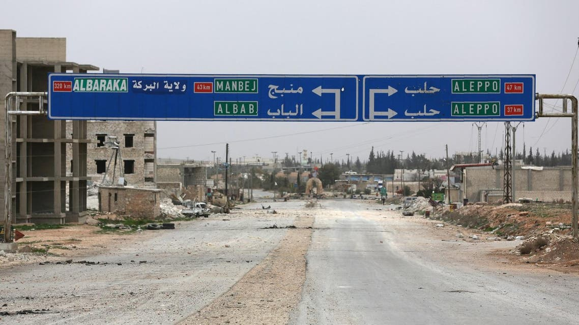 A road sign that shows the direction to Manbij city is seen in the northern Syrian town of al-Bab. (Reuters)