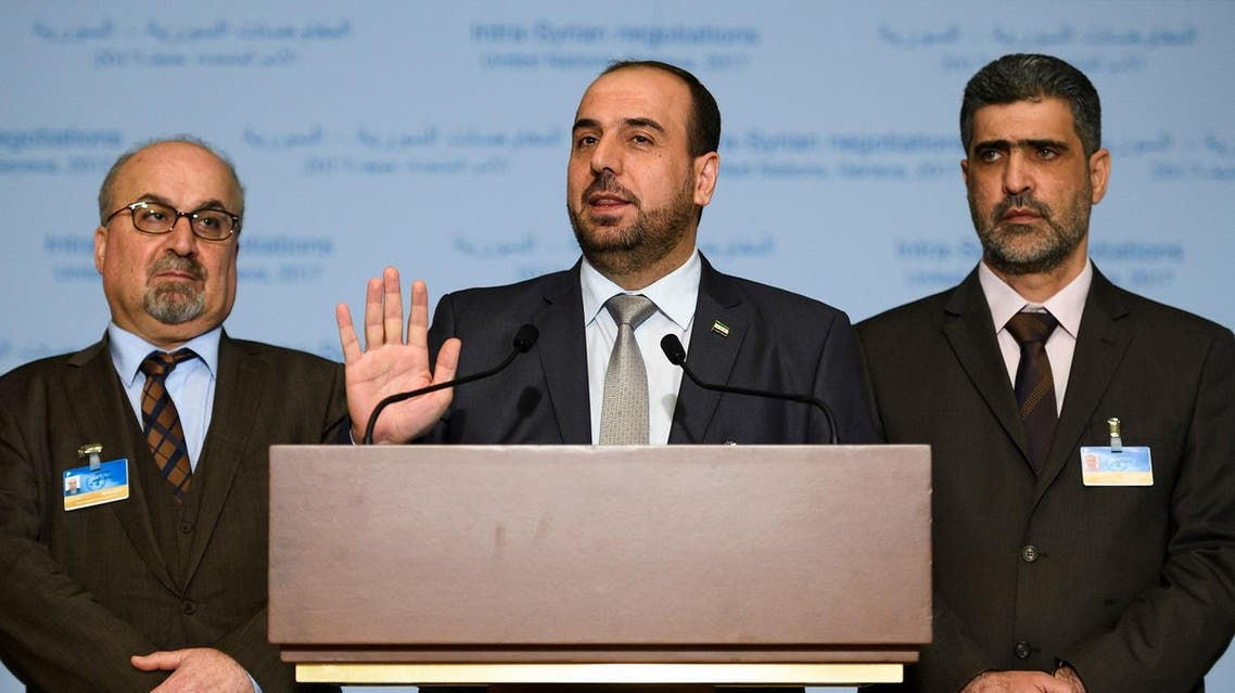 """Syria's main opposition High Negotiations Committee (HNC) leader Nasr al-Hariri (C) gestures between members of the delegation Abdulahad Astepho (L) and Bashar al-Zouabi during a press conference on Syria peace talks on February 27, 2017 in Geneva. A ban on mobile phones, recording devices and """"offensive language"""": the ground rules handed out at Syrian talks reflect the high tension in the corridors of Geneva, where peace is a long way from anyone's lips. Fabrice COFFRINI / AFP"""