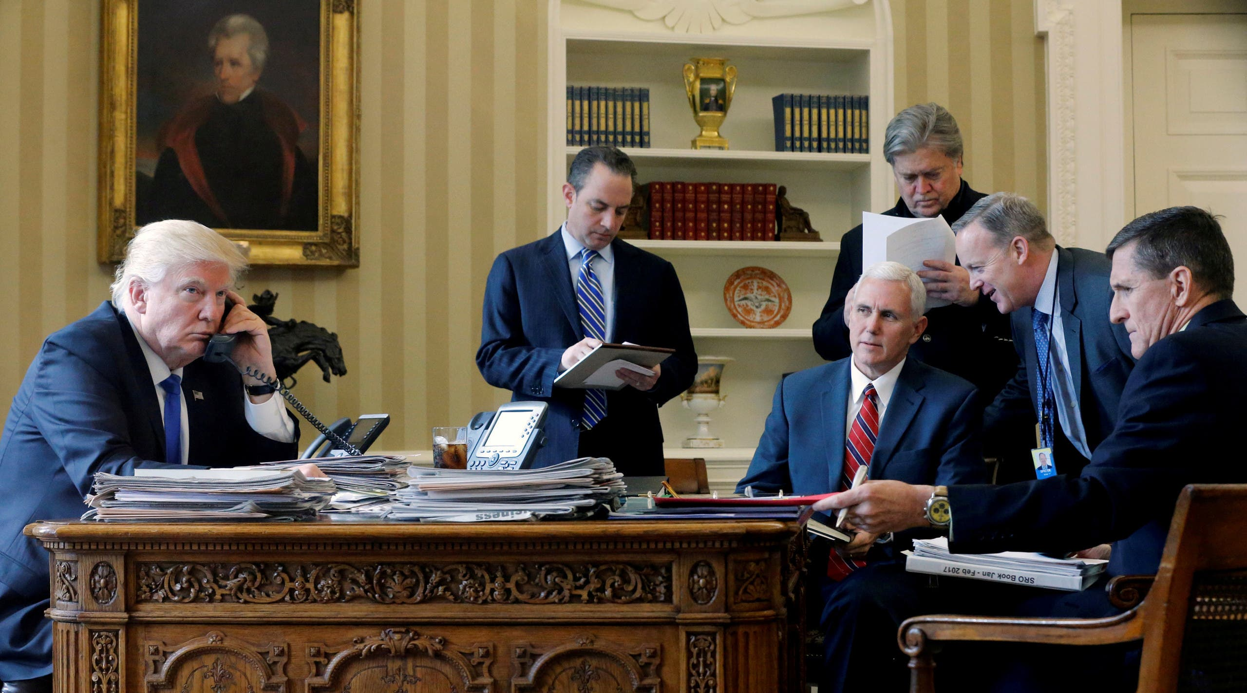 U.S. President Donald Trump (L-R), joined by Chief of Staff Reince Priebus, Vice President Mike Pence, senior advisor Steve Bannon, Communications Director Sean Spicer and National Security Advisor Michael Flynn, speaks by phone with Russia's President Vladimir Putin in the Oval Office at the White House in Washington, U.S. January 28, 2017