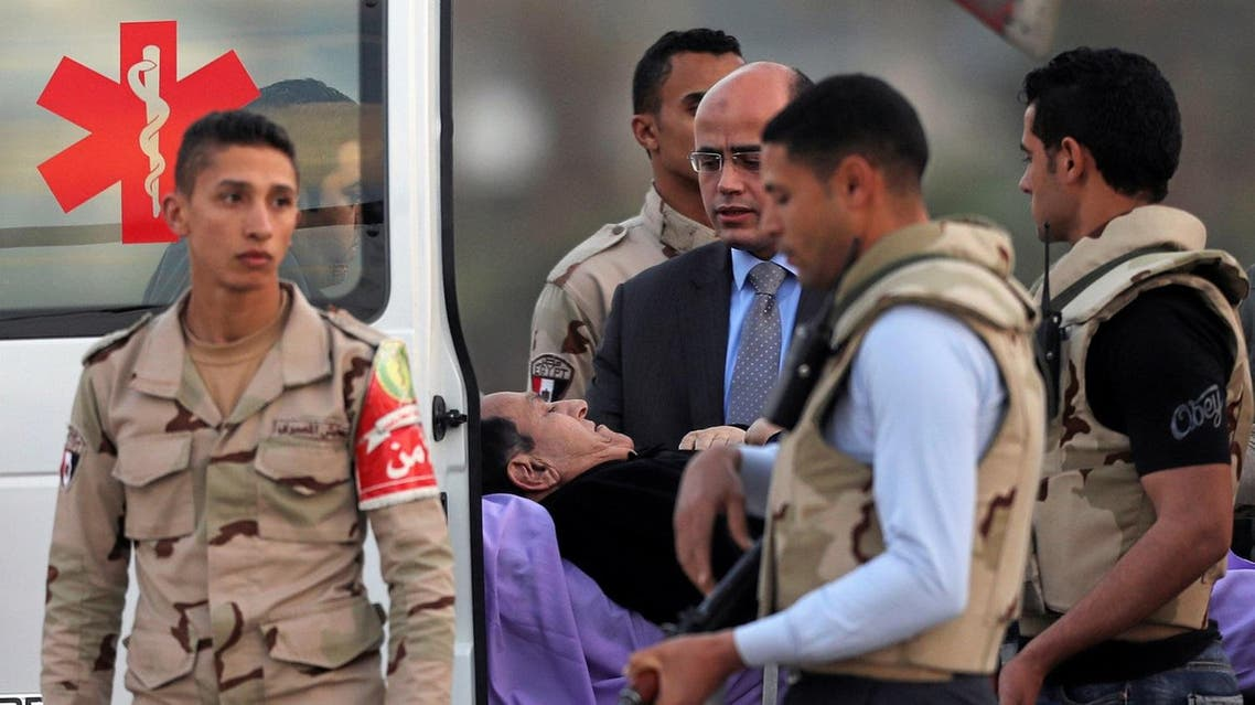 Former Egyptian President Hosni Mubarak lies on a stretcher after getting back from his trial to the military hospital in Cairo. (Reuters)