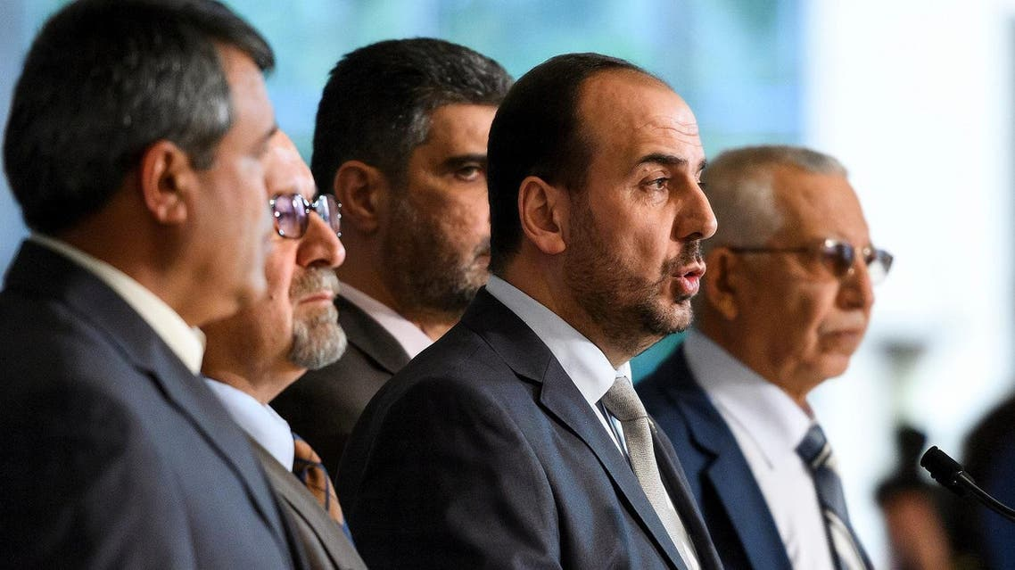 Syria's main opposition High Negotiations Committee (HNC) leader Nasr al-Hariri (2nd R) speaks to reporters after a meeting with UN Special Envoy during Syria peace talks on February 27, 2017 in Geneva. (AFP)