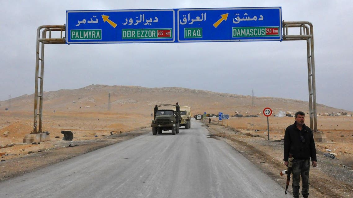 A picture taken on March 2, 2017, shows a sign displaying the routes to Palmyra-Deir Ezzor and Damascus-Iraq. (AFP)