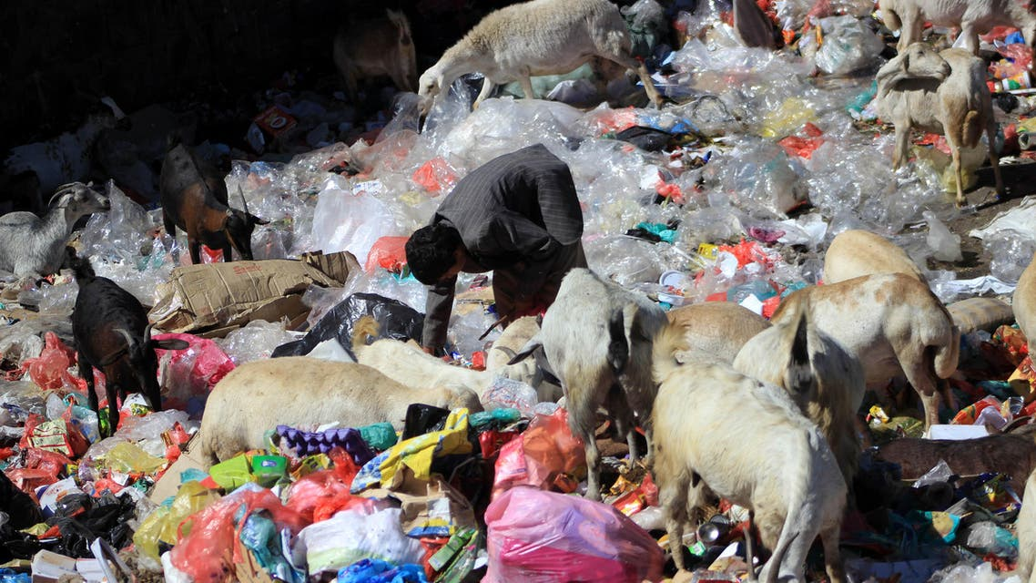 A Yemeni child collects items from the rubbish in the capital Sanaa on November 20, 2016 on the UN Universal Children's Day.  AFP