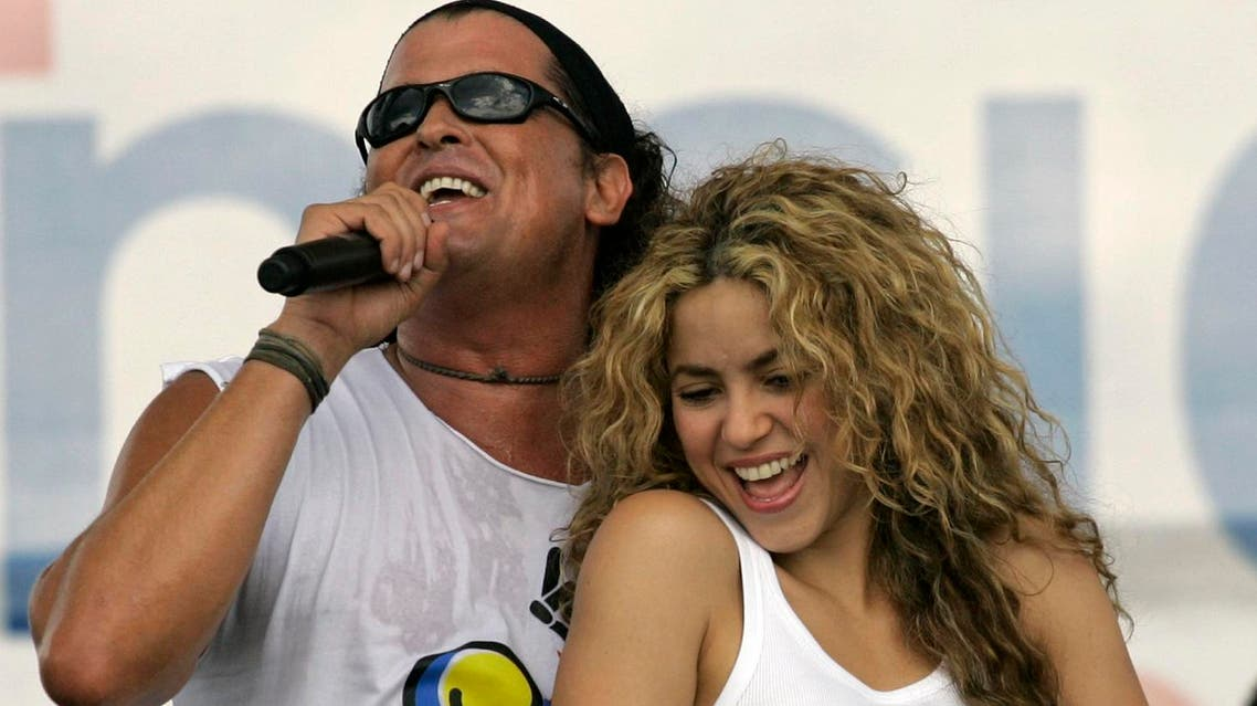 "In this July 20, 2008 file photo, Colombian singers Shakira, right, and Carlos Vives perform during a ""concert for peace"" Independence Day celebrations in Leticia, Colombia. (AP)"