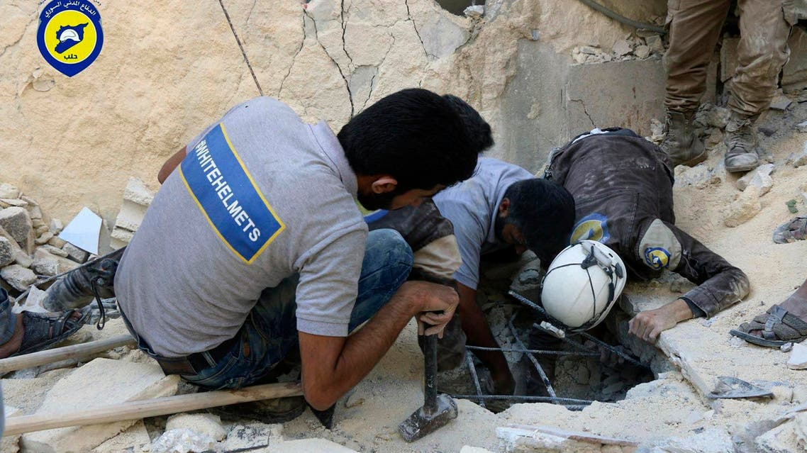 White Helmets workers search underground in Aleppo, Syria. (File photo: AP)