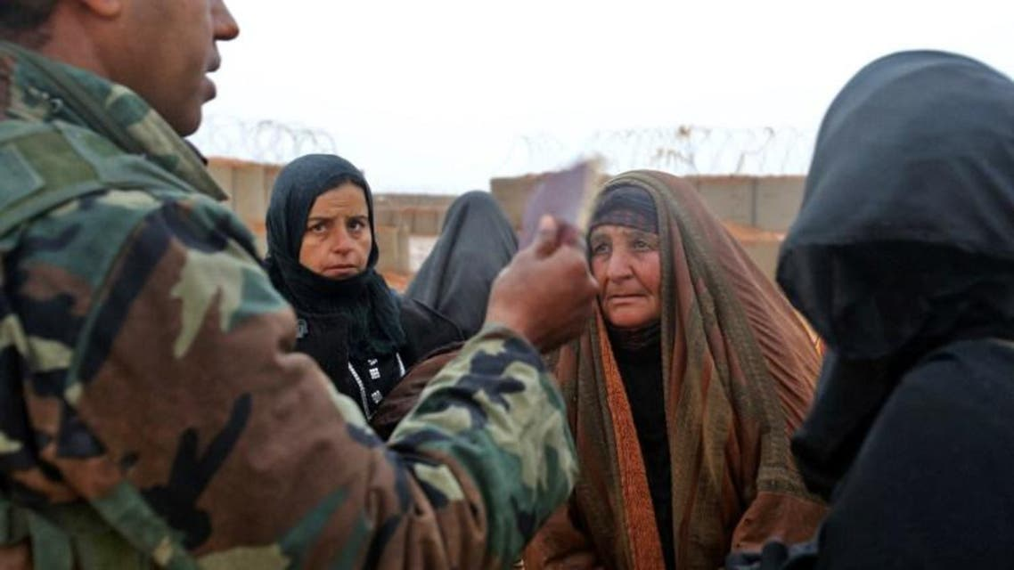 Syrian refugees from the informal Rukban camp, which lies in no-man's-land off the border between Syria and Jordan. (AFP)