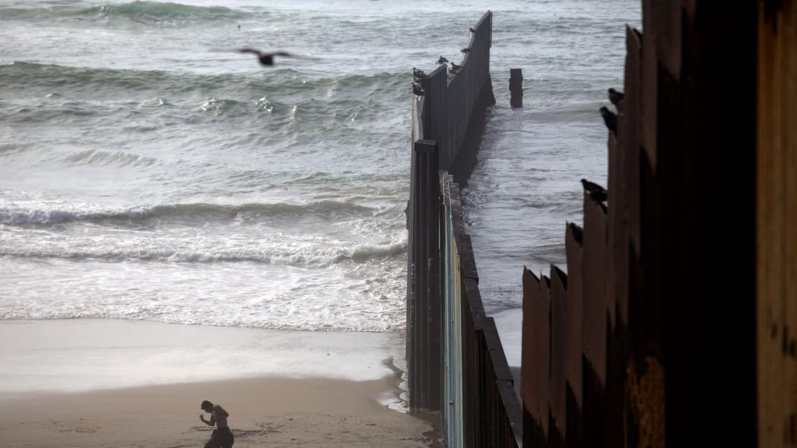 This photo taken on February 14, 2017 shows a man working out on the beach next to the Mexico-US border at Playas de Tijuana, northwestern Mexico. Built to keep out migrants, traffickers, or an enemy group, border walls have emerged as a one-size-fits-all response to the vulnerability felt by many societies in today's globalized world, says an expert on the phenomenon.