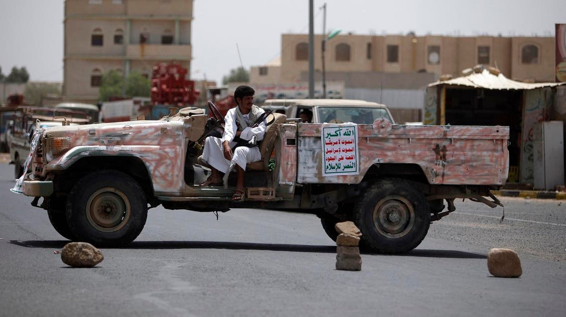 A militant from the Houthi Shiite militia group keeps guard in a patrol vehicle securing a street during a tribal gathering in the northwestern Yemeni city of Saada. (File photo: Reuters)