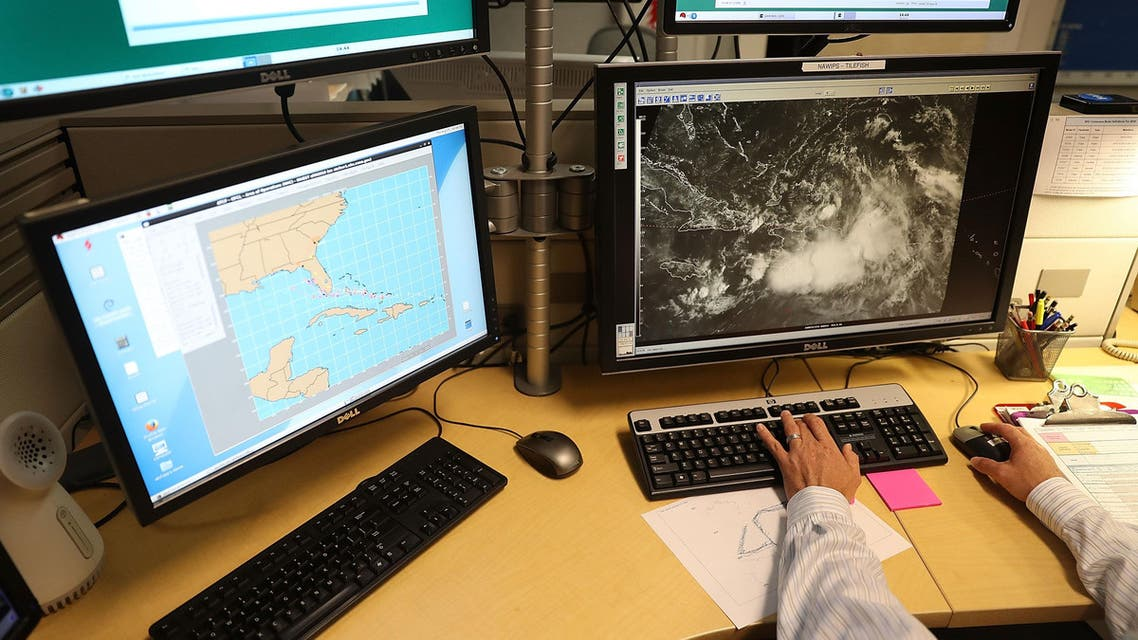 Senior Hurricane Specialist, works at the National Hurricane Center to track the path of a weather disturbance that has produced tropical storm-force wind gusts between 40 and 50 mph in heavy squalls over some of the northern Caribbean islands and surrounding waters and is of concern to the South Florida region on August 25, 2016 in Miami, Florida.