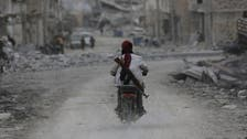 Syrian fighters cut main road linking ISIS-held areas