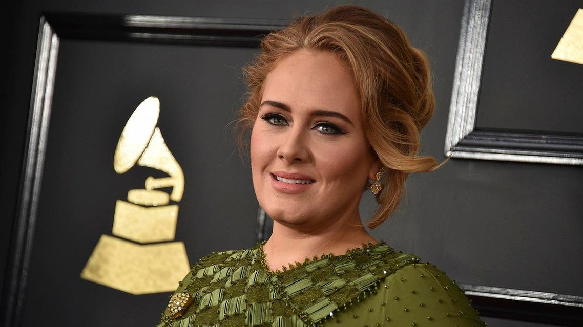 In this Feb. 12, 2017, file photo, Adele arrives at the 59th annual Grammy Awards at the Staples Center in Los Angeles. Adele confirmed her marriage to partner Simon Konecki in remarks to the audience at her concert in Brisbane, Australia, on Saturday, March 4, 2017. (AP)