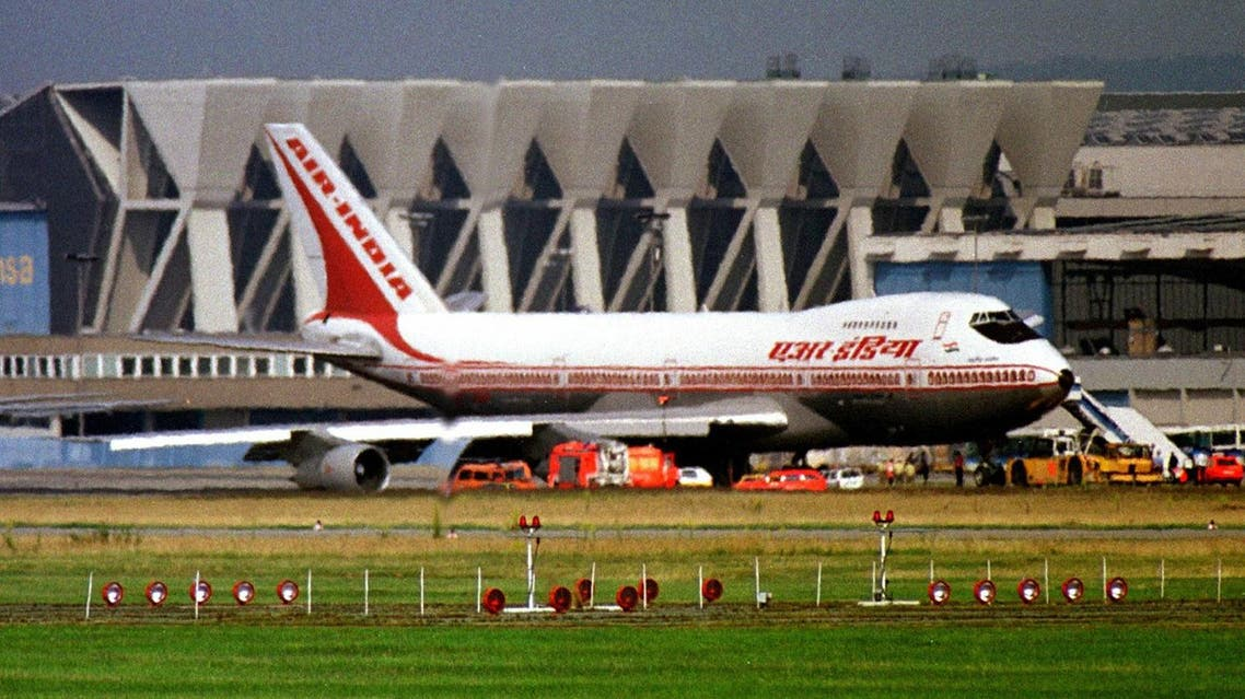 A plane from Air India sits on the tarmac after it made an emergency landing at Frankfurt Rhine Main Airport June 29. The Boeing airplane from New Dehli made the emergency landing after it was unable to activate a part of its landing gear.