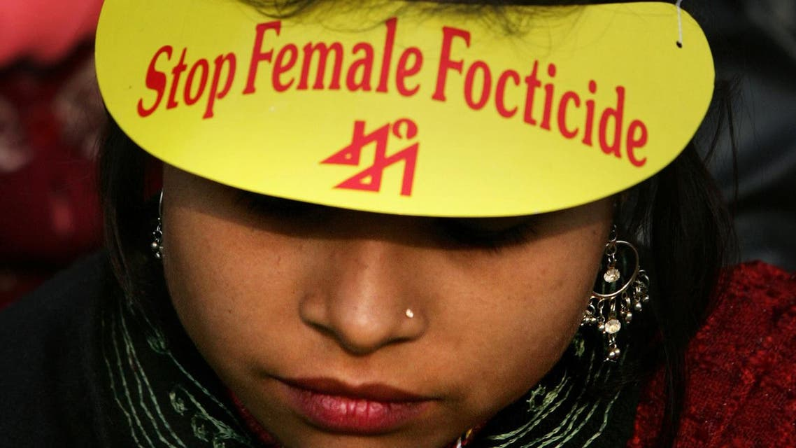 A woman looks on during a rally against female foeticide in New Delhi, India, Dec. 10, 2006. (File Photo: AP)