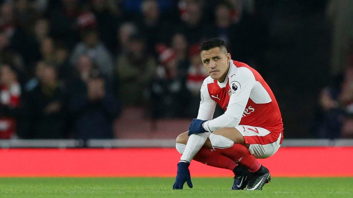 Arsenal's Alexis Sanchez looks across the pitch before the English Premier League soccer match between Arsenal and Stoke City at the Emirates stadium in London, Saturday Dec. 10, 2016. (AP)