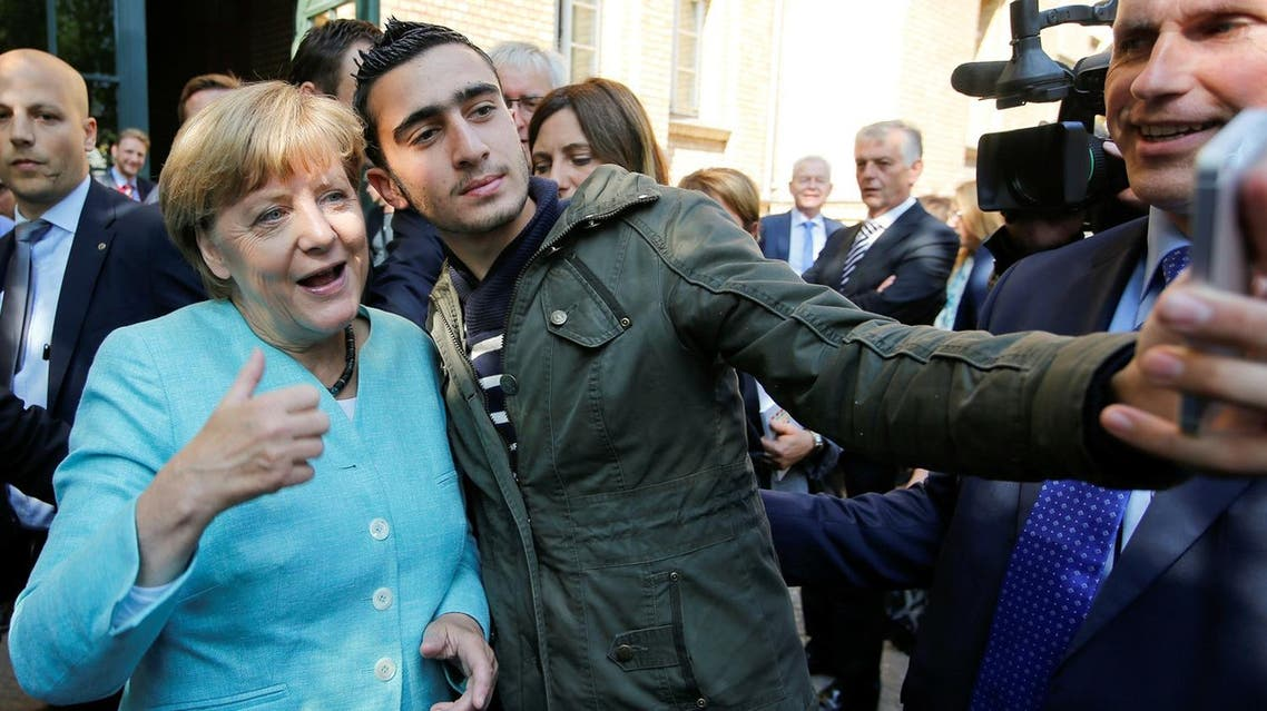 Syrian refugee Anas Modamani takes a selfie with German Chancellor Angela Merkel outside a refugee camp near the Federal Office for Migration and Refugees after registration at Berlin's Spandau district, Germany September 10, 2015. REUTERS