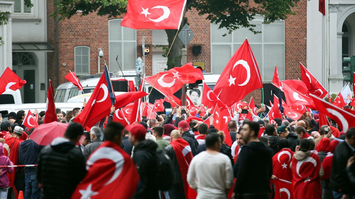Turkish community gathers with flags in front of the Turkish Consulate in Hamburg, northern Germany, on July 16, 2016, to protest against a military coup attempt in Turkey