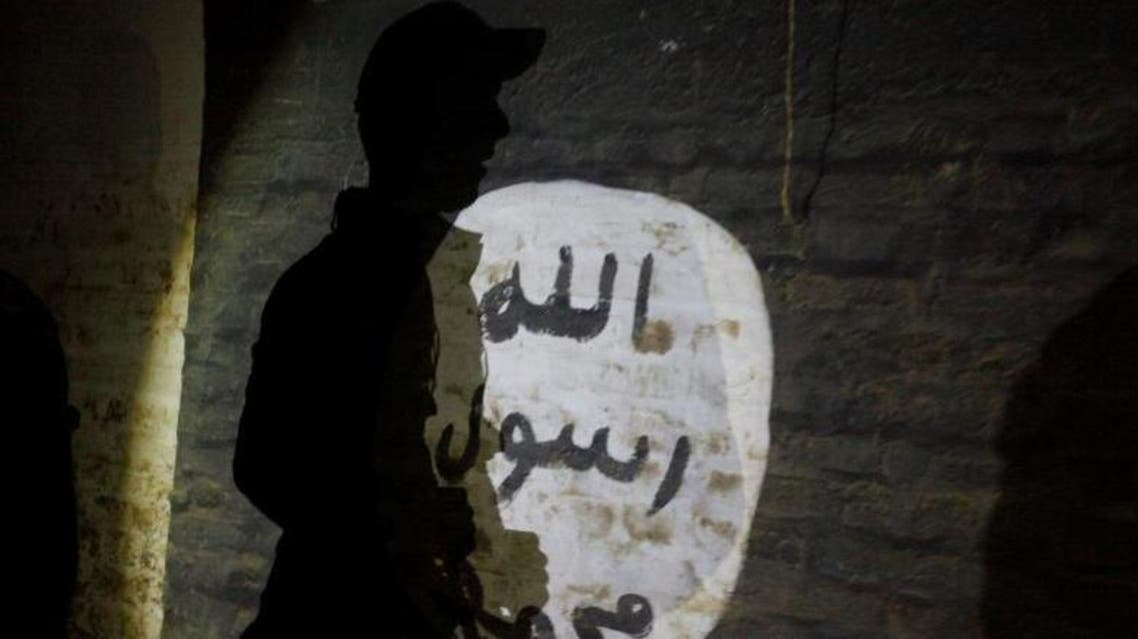 A view of ISIS slogans painted along the walls of the tunnel. It is not clear how many recruits passed through the camp or what became of them. (Reuters)