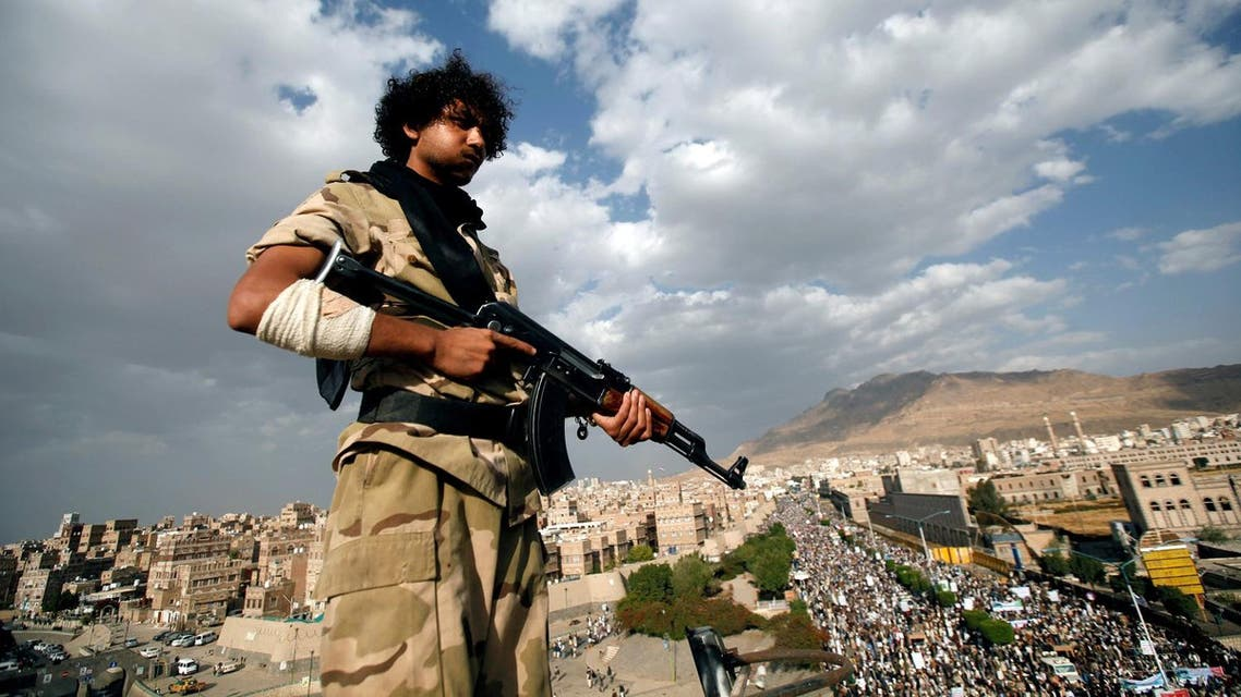 Houthi militant stands guard on the roof of a building overlooking a rally attended by supporters of the Houthi movement in Sanaa, Yemen. (Reuters)