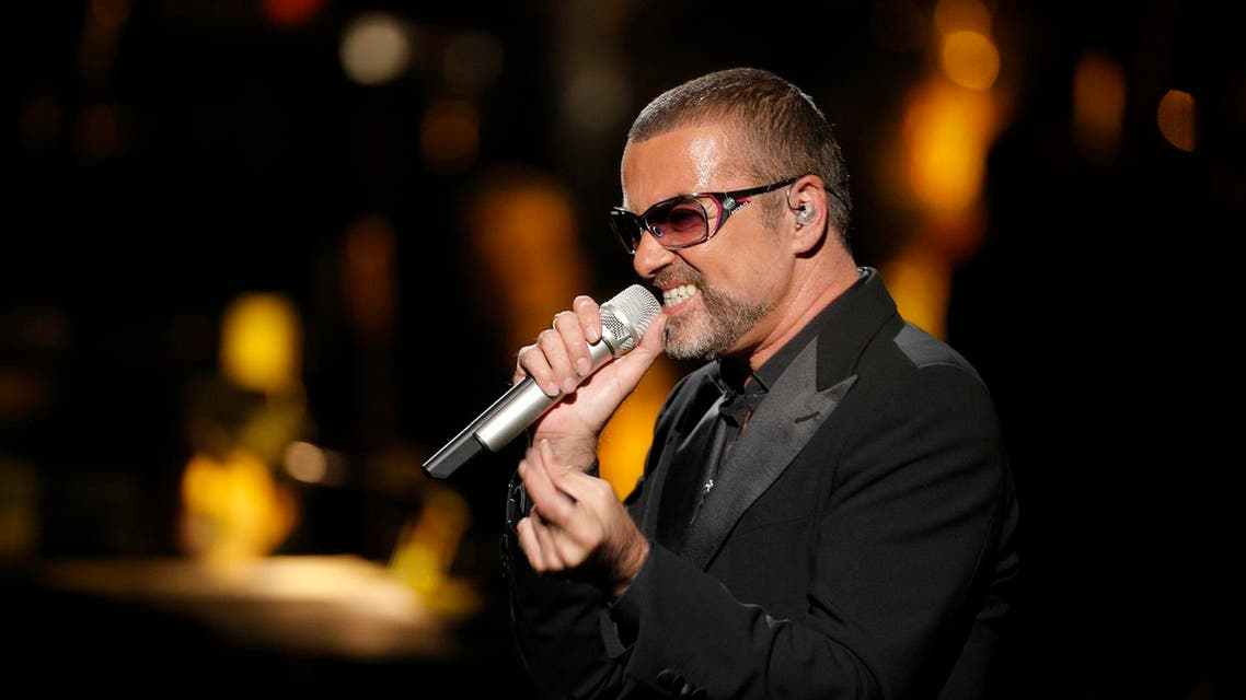 British singer George Michael performs at a concert to raise money for AIDS charity Sidaction, during the Symphonica tour at Palais Garnier Opera house in Paris, France, Sunday, Sept. 9, 2012. (AP)