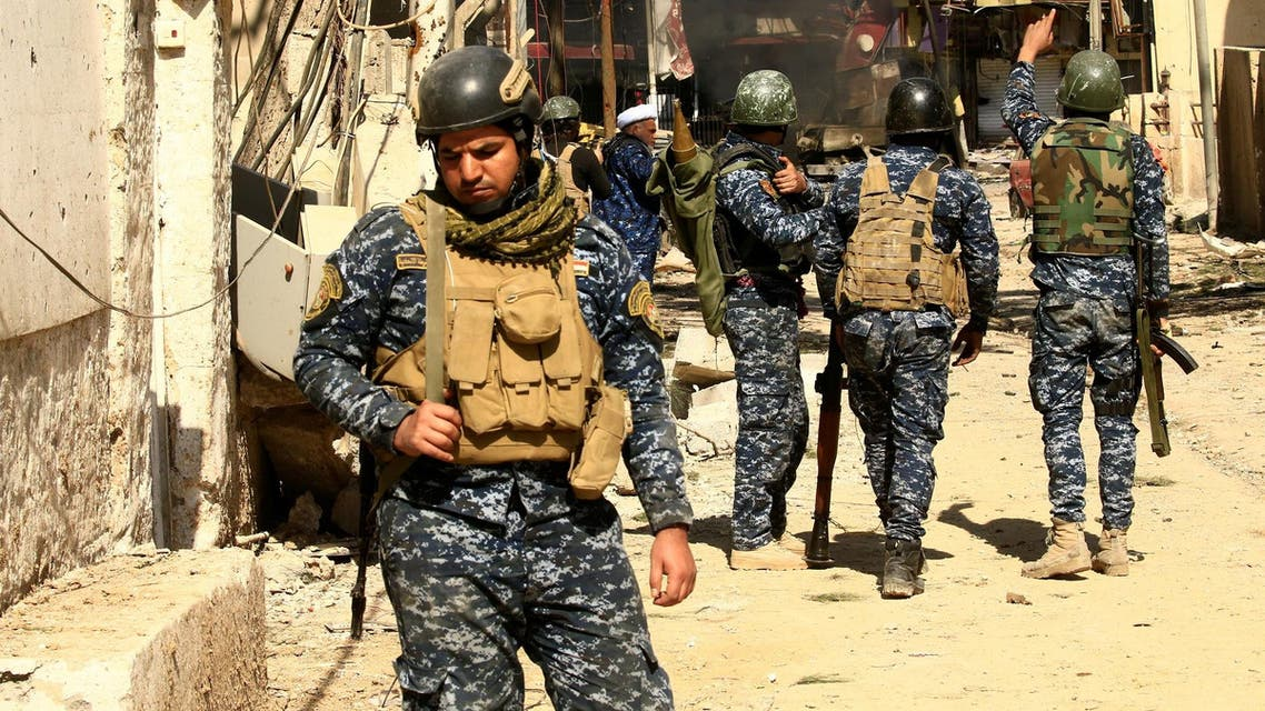 Federal police members gather during a battle with ISIS militants in Mosul. (Reuters)