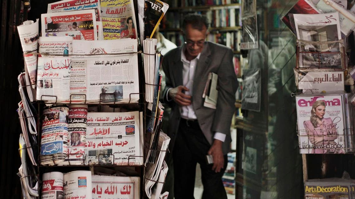 An Egyptian walks past a stand displaying state-owned newspapers in Cairo, Egypt, Dec. 4, 2012. (File photo: AP)