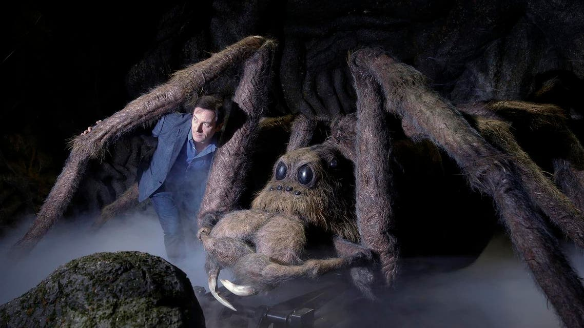Actor Jason Isaacs poses for the media next to Aragog the Acromantula at a new extension called the 'Forbidden Forest' to the Warner Brothers studio tour 'The Making of Harry Potter' in Watford, England, Wednesday, March 8, 2017. (AP)