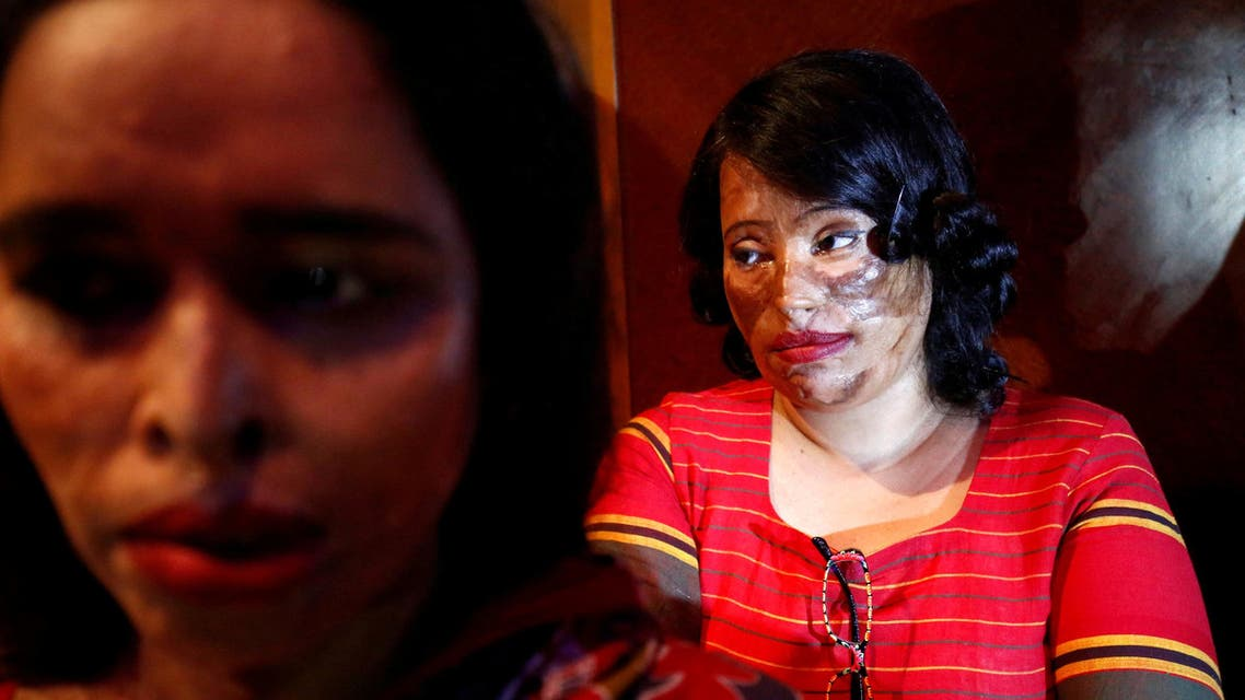 "Acid attack survivors wait in the back stage prior to participate in a fashion show titled ""Beauty Redefined"" organized by ActionAid Bangladesh in Dhaka, Bangladesh, March 7, 2017. Picture taken March 7, 2017. REUTERS/ Mohammad Ponir Hossain TPX IMAGES OF THE DAY TPX IMAGES OF THE DAY"