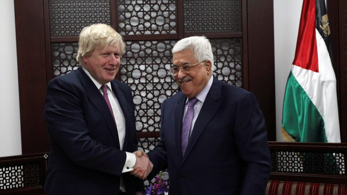 Britain's Foreign Secretary Boris Johnson shakes hands with Palestinian President Mahmoud Abbas during their meeting in the West Bank city of Ramallah, March 8, 2017. REUTERS/Mohamad Torokman
