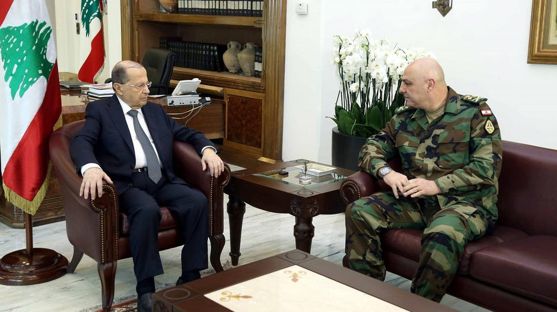 A handout picture provided by the Lebanese photo agency Dalati and Nohra on March 8, 2017 shows President Michel Aoun (L) meeting with the newly appointed army chief, General Joseph Aoun. (AFP)