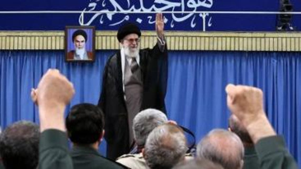 A handout picture released on September 18, 2016 by the official website of the Centre for Preserving and Publishing the Works of Iran's supreme leader Ayatollah Ali Khamenei shows him gesturing to the commanders of Revolutionary Guards during a meeting in Tehran. A portrait of the Islamic republic's late founder, Ayatollah Khomenei (L), is seen on the wall. AFP