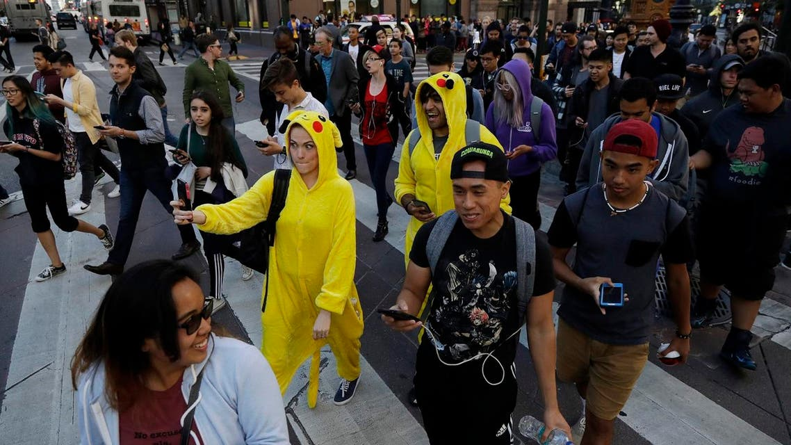 """Pokemon Go"" players walk along Market Street, July 20, 2016, in San Francisco. (File Photo: AP)"