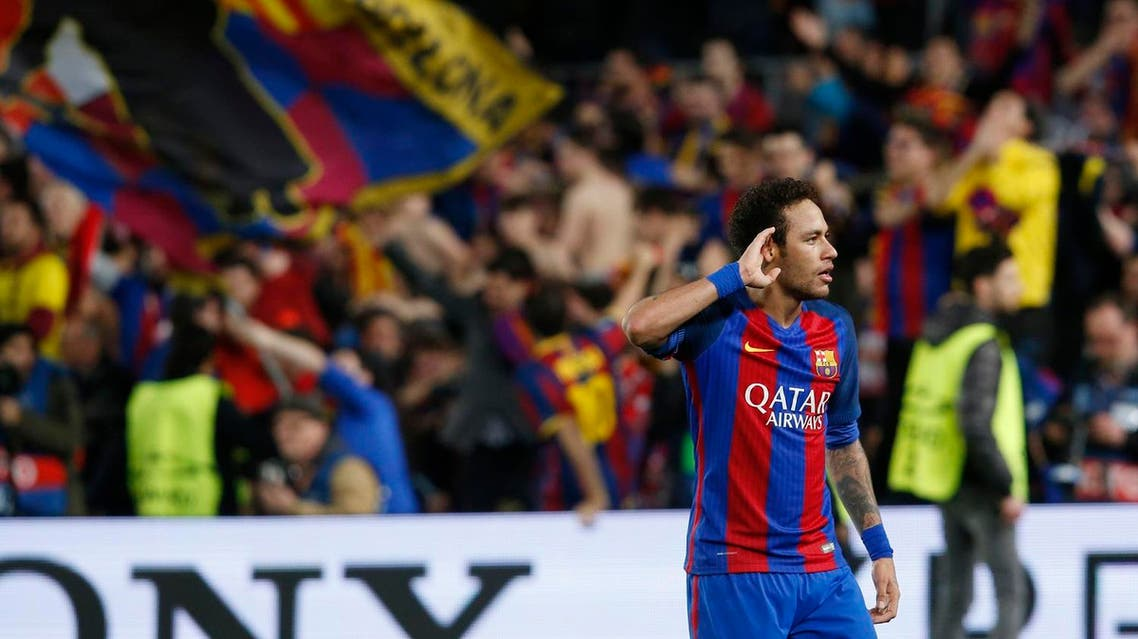 Barcelona's Brazilian forward Neymar celebrates at the end of the UEFA Champions League round of 16 second leg football match FC Barcelona vs Paris Saint-Germain FC at the Camp Nou stadium in Barcelona on March 8, 2017. (AFP)