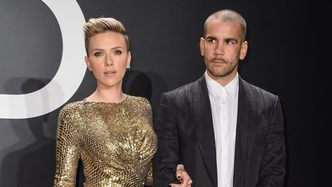 Scarlett Johansson, left and journalist Romain Dauriac at the Tom Ford Autumn/Winter 2015 Womenswear Presentation on Feb. 20, 2015, in Los Angeles. (File Photo: AP)