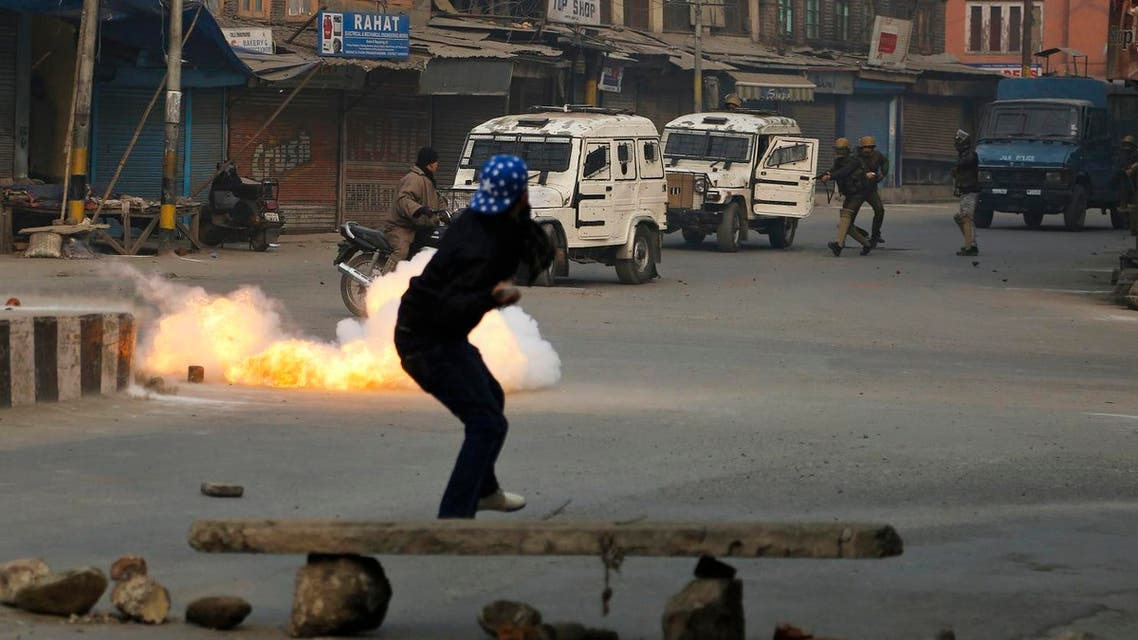 A Kashmiri civilian crosses a road as a tear gas shell directed towards protestors explodes near him in Srinagar, Indian controlled Kashmir, Dec. 30, 2016. (File Photo: AP)