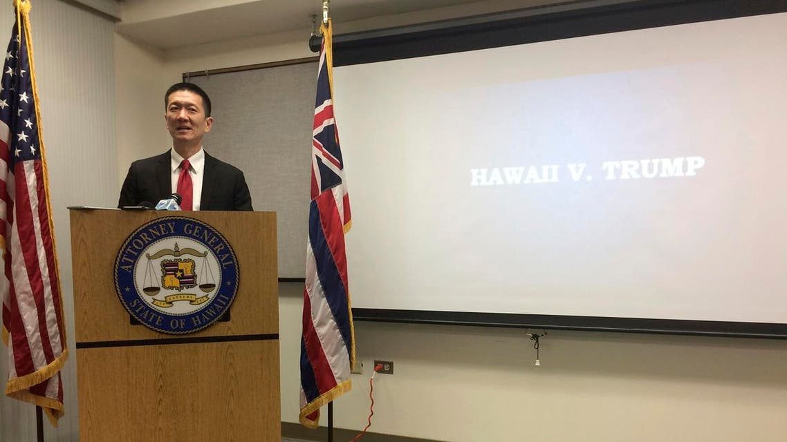 Hawaii Attorney General Doug Chin speaks at a news conference in Honolulu on Friday, Feb. 3, 2017 announcing the state of Hawaii has filed a lawsuit challenging President Donald Trump's travel ban. (AP)