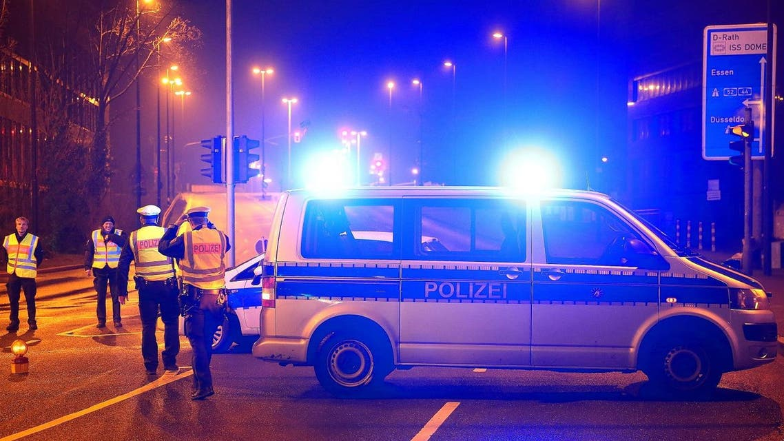 Policemen block a road near the site where a unexploded World War II bomb was found in Duesseldorf, western Germany, on March 8, 2017. (AFP)