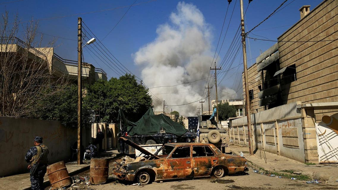 Smoke rises from a car bomb that exploded during a battle with Islamic State militants in Mosul, Iraq, March 6, 2017. REUTERS